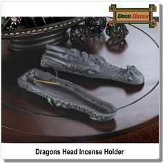 Dragons Head Incense Holder - This fierce beast holds a secret! Lift the top of this dragon's finely detailed head to reveal an incense holder that will help you fill your room with magical aroma of your choice. When finished, replace the top to enjoy the dark allure of this mythic decor accent.