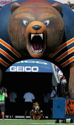 Chicago Bears mascot | Staley, the mascot of the Chicago Bears, sits under an inflatable bear ...
