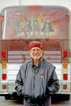 """Willie Nelson poses with his bus """"Honeysuckle Rose"""" outside the Mirage Casino in the early Nineties in Las Vegas."""