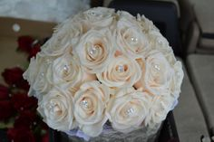 bridal bouquet white roses with crystals, I like this but with only a few roses and various white flowers