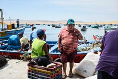 Fisherman in Lagunillas, Paracas, Peru. They came back after a hard day under the sun and were performing the last tasks as unloading fish and cleaning up the boats.
