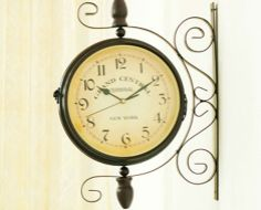 29 for a double dial iron wall clock details clock on both