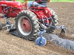 A rough setup using a Farmall Cub to lay down weed barrier and have the discs cover the ends before planting Farmall Tractors, Ford Tractors, Farmall Super C, Garden Tractor Attachments, Tractor Pictures, Weed Barrier, Train Truck, Red Tractor, Farm Tools