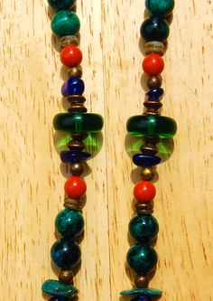 Showing vintage glass beads, Azurite beads, copper spacers, round brass beads, and tiny shell spacers.