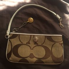 Coach little purse Small bag/purse Coach . Color Is beije with C brown . Leather white around And on the hand support. This item Is not new but Is in great conditions. Thank You And happy shopping !!! Coach Bags Mini Bags