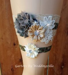 #Camo can be sexy for weddings!  Sexy camo #wedding #garter set is camouflage with serious style. Ivory stretch lace wedding garter is banded in army/  hunters camo stretch elastic.  Army camouflage shabby r... #bride #camogarter #rusticwedding #camowedding #sexycamo