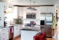 Wood floor, white cabinets, dark counters