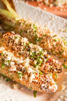 Mexican corn on the cob on the grill with a mayo lime mixture with cumin and smoked paprika. Topped with Cojita cheese and cilantro gives it a fresh flavor that you'll love!