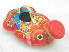 Cute vintage tin litho fish watering can.