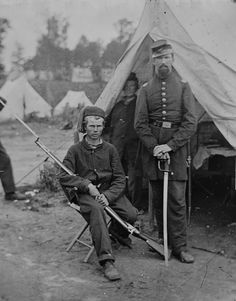Two Union soldiers, the young one on the left is a 'Zouave'. Circa 1862.