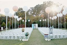I WILL be having oversized balloons at my wedding. Oversized blush and white balloons just like this! Also will have oversized blush balloons in some of our wedding photos. And a balloon release! Wedding Balloon Decorations, Wedding Balloons, Wedding Ceremony Backdrop, Outdoor Ceremony, Wedding Seating, Ceremony Seating, Beach Ceremony, Giant Balloons, Helium Balloons