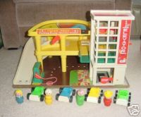 Fisher Price garage.  OMG my brothers wore this OUT.  Anything with wheels was raced down that ramp!