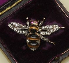 A tiger's eye and diamond bee brooch