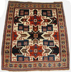 """so-called """"Star"""" Kazak Object Name: Carpet Date: early 19th century Geography: South Caucasus, Kazak Medium: Wool (warp, weft, and pile); symmetrically knotted pile Dimensions: L. 74 in. (187.96) W. 64.00 in. (162.56 cm) Classification: Textiles"""