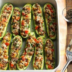 Italian Sausage-Stuffed Zucchini Recipe -I've always had to be creative when getting my family to eat vegetables, so I decided to make stuffed zucchini using the pizza flavors that everyone loves. It worked! We like to include sausage for a main dish but it could be a meatless side dish, too. —Donna Marie Ryan, Topsfield, Massachusetts