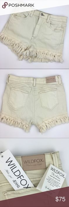 "[Wildfox] Helena Boho Fringe Hi Rise Shorts Gypsy Helena style shorts by Wildfox. Super high rise cutoffs. Crochet detail at hem with fringe. Off white/cream color called ""Vintage Lace"". Soft and stretchy. So comfortable.  Fabric: 98% Cotton 2% Spandex  Waist: 14"" Inseam: 2"" Rise: 11"" Condition: NWT. Tags are not attached, but are included. They have never been worn.  No Trades! Measurements taken while laying flat. Wildfox Shorts"