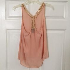 Racerback chain tank Super cute top! Some chains coming loose as pictured. Still cute & wearable! Not from listed brand. Anthropologie Tops Tank Tops