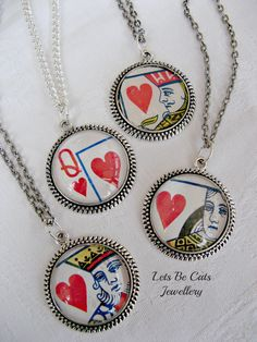 A selection of Kings and Queens of Hearts  pendants.  Made from recycled playing cards to provide striking jewellery.  £8 plus p from https://www.facebook.com/LetsBeCatsJewellery