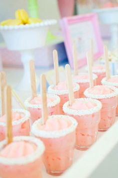 Strawberry mousse served in candy-rimmed miniature glasses