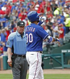 Texas Rangers right fielder Nomar Mazara (30) celebrates after hitting a home run off of Los Angeles Angels starting pitcher Hector Santiago (53) at Globe Life Park in Arlington, Texas May 25, 2016. (Nathan Hunsinger/The Dallas Morning News)