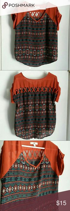 Tribal print top Super cute top with lattice cut out back and cuffed sleeves with buttons. Burnt orange, navy, white, creme, brown and green tribal print. Size L. Ya Los Angeles Tops Blouses