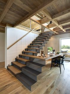 ♂ Contemporary interior design home with unique stair geometry mimicked by table - Far Pond by Bates Masi Architects