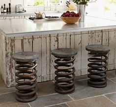 "re-purposed truck springs become kitchen stools.  i love adding industrial ""splashes"" in my decorating.  they're unexpected, fun, and great conversation pieces!"