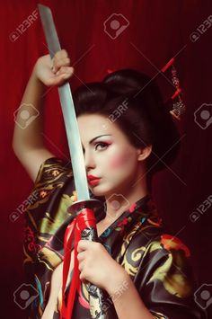 Beautiful Geisha In Kimono With Samurai Sword Stock Photo, Picture And Royalty Free Image. Image 25613161.