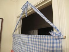 An easy to make (no really, it is!) doorway puppet theater is a sure way to add lots of fun to your familys day.
