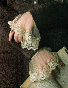 ELIZABETHAN LACE CUFFS Embroidered illusion is gathered upon elasticized lingerie lace to peek out beneath sweaters and blazers.