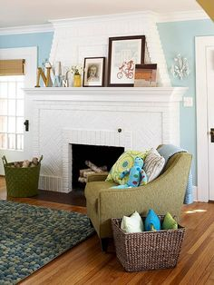 painted brick fireplace with a pop of color here and there