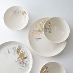 Modern dishware with gray and gold scuffs