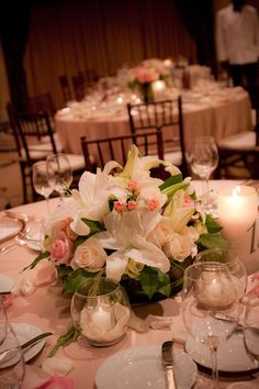 Lilies compliment the arrangment perfectly ... adding a little ambience to the setting
