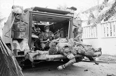 03 Feb 1968, Near Tan Son Nhut Airbase, Saigon, South Vietnam --- The bodies of US soldiers lay on the back of an armored personnel carrier which moved through the fighting near Tan Son Nhut Airbase to pick up the dead. --- Image by © Bettmann/CORBIS