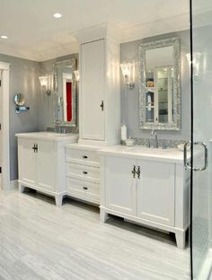 *This is a cool vanity set-up. I like the additional storage in between the vanity areas. - DF