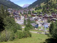 """Morgins, Switzerland, where I stayed each year.  This is the ski lift I would ride to """"meet"""" the grazing Swiss cows....since there's no skiing in the summer!"""
