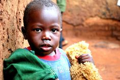Child in the Namatala slum, his family rents from Veronica.