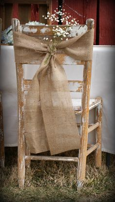 Pretty burlap chair back decor. Perfect for a country, rustic or barn style wedding.
