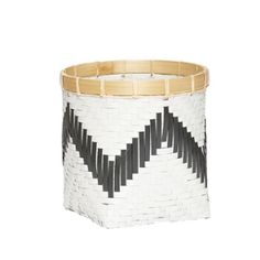 Medium White + Black Chevron Rattan Basket: Two rattan baskets with a striking monochrome + chevron design and natural bamboo rim.  Style the large as a planter with a rich green leafy plant to hit the key Greenery trend of 2017. Use the medium in your dining area to hold cutlery and textiles. Available individually or as a set of two. Made from rattan and bamboo.
