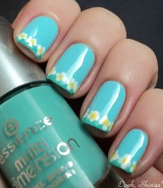 Light Blue Nail Designs   Light blue nails with little white flowers with yellow centers