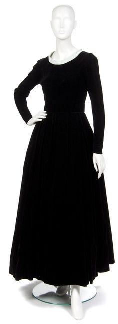 A Mainbocher Black Velvet Evening Gown,  with green silk trim at neckline