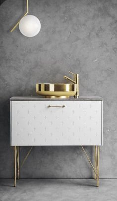 white superfront bathroom cabinet with brass sink
