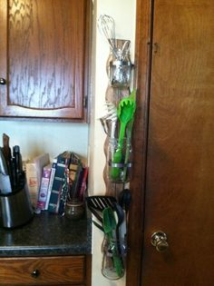 Kitchen Utensil Storage made from Mason Jars, Wood Trim, and Hose Clamps.  Matching Drawer Divider.