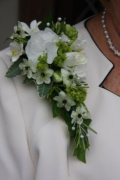 This is how a corsage should be worn.  Flower Design Buttonhole & Corsage Blog: Design Ladies Corsage