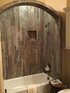 ceramic tile with wood look run vertically in bathroom