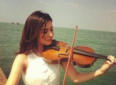 Aom playing violin
