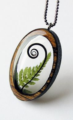 resin and wood necklace with tendril & fern leaf <3