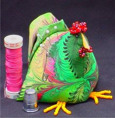 Banty Chicken Pincushion: http://www.susaglenndesigns.com/Sewing_Whimsies_s/67.htm