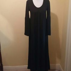 Black Empire waist Maxi Dress This maxi has a fun 60's flare to it!! Made of 97% Rayon/3% spandex. This dress is an empire waist with a bell sleeve and a slight V neck. It is slightly longer in the back. Reborn Dresses Maxi