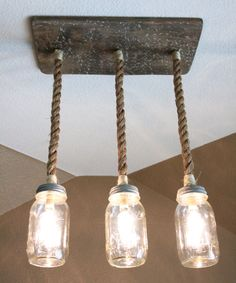 Update your light fixtures with mason jars rustic triple pendant mason jar chandelier with nautical rope and wood base aloadofball Gallery